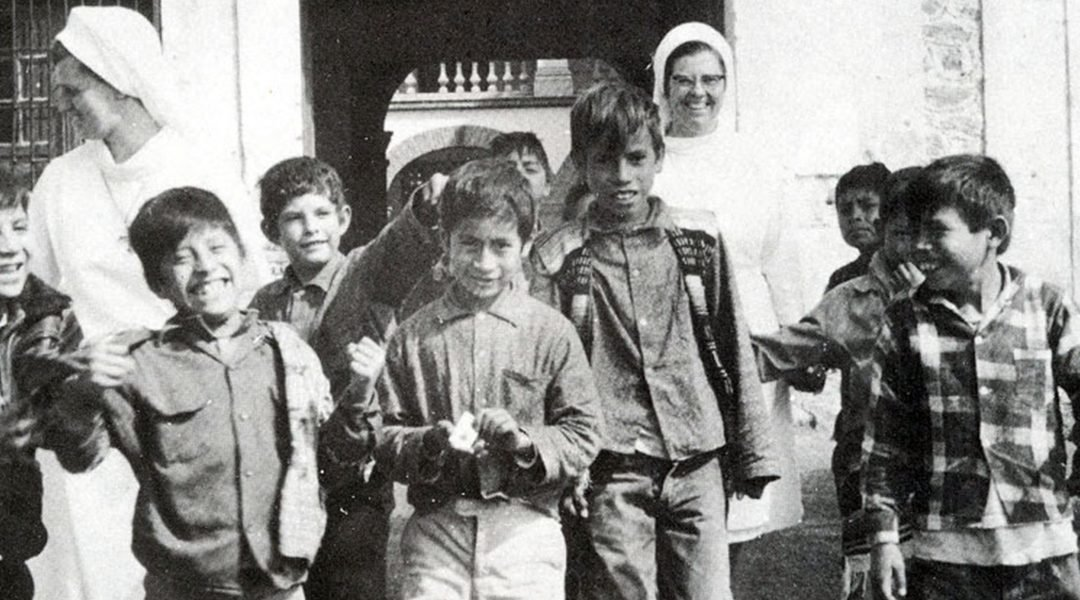 Fr. Wasson and the pequeños are grateful to have the help of the Sisters in 1974