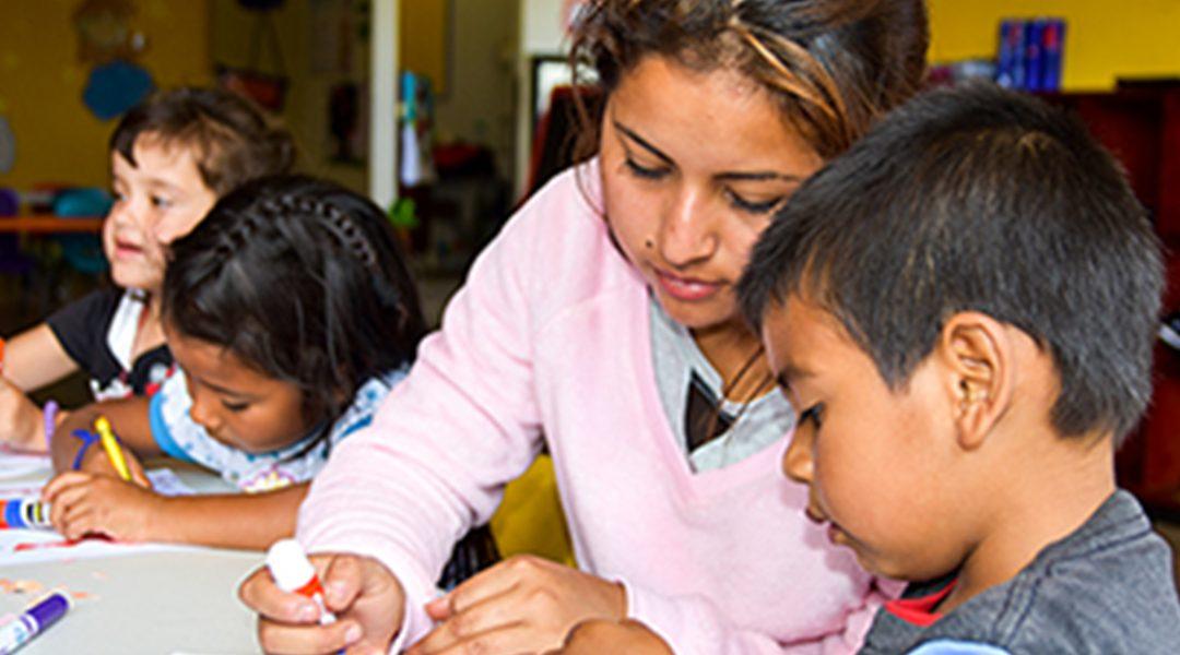 NPH Guatemala Volunteer helping children with an art project