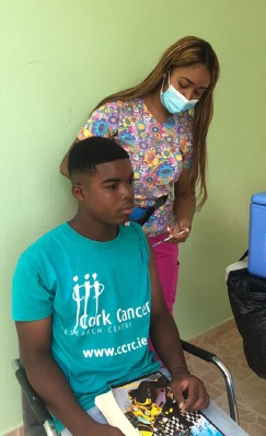 Boy sitting on a chair getting vaccinated